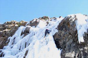 Reaching the top ice climbing