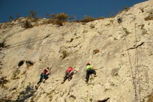 Children try rock climbing on a summer adventure holiday