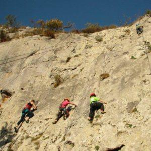 Children try rock climbing on a summer adventure holiday