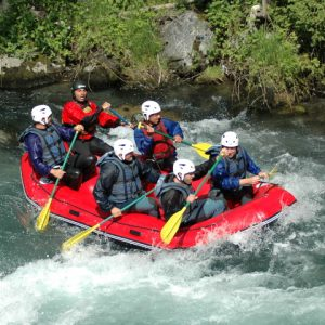 Heading down river in a raft in the Pyrenees