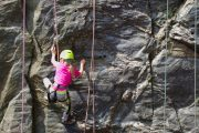 Kids problem solving while rock climbing