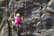 Kids problem solving while rock climbing