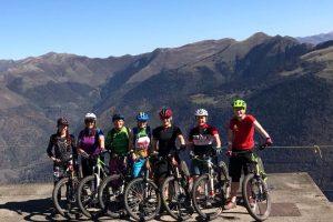 Women mountain biking holiday group Pyrenees