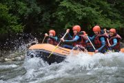 Family river rafting in the Pyrenees