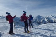 Reaching the summit on a Pyrenees snowshoeing holiday