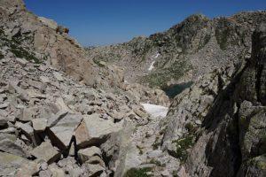 Boulder strewn paths and lake