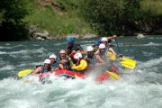 Mates having fun rafting on the river