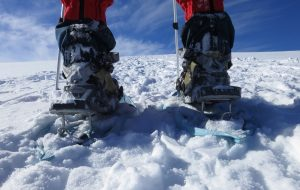 Use the heel riser bars on the snowshoes