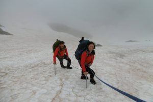 Learning rope skills on summer alpinism course