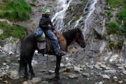 Waterfall and horse rider on a Pyrenees riding holiday