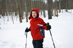 Boy on family snowshoeing adventure