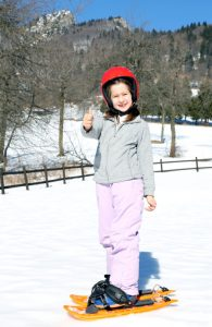 Snowshoeing girl on a family snowshoe adventure
