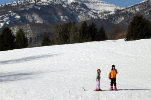Children on a family snowshoe adventure