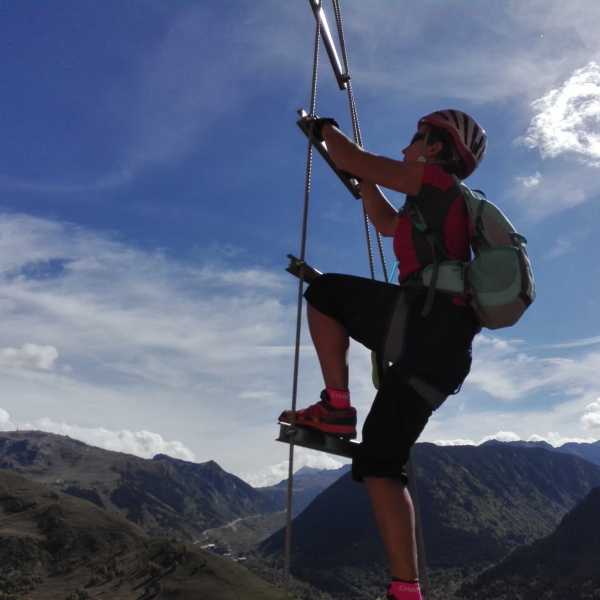 Challenging via ferrata on a family adventure holiday with teens