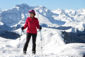 lady snowshoeing in the Pyrenees mountains